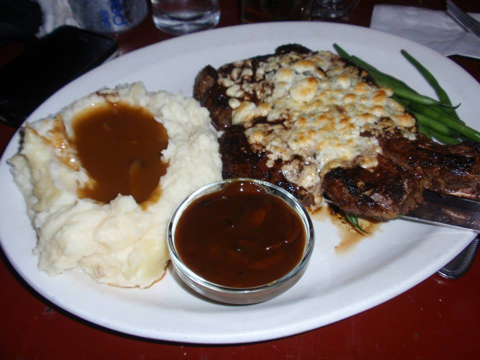 Ribeye steak, topped with blue cheese, served with mushroom gravy.  Mmmmm!