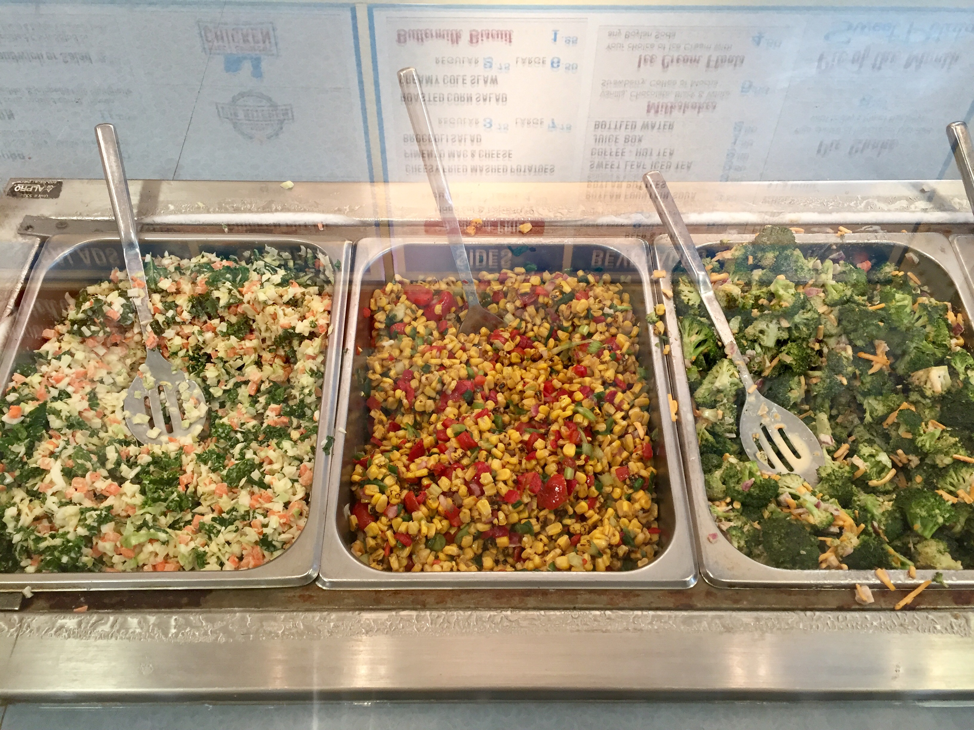 Three kinds of slaw: kale & cabbage, corn & pepper, and broccoli.